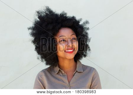 Beautiful Smiling Woman With Afro By White Wall