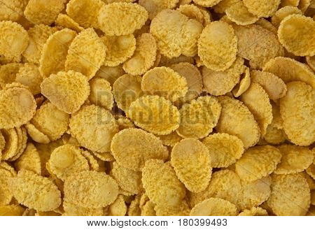 background of goldish corn flakes, tasty, natural, delicious