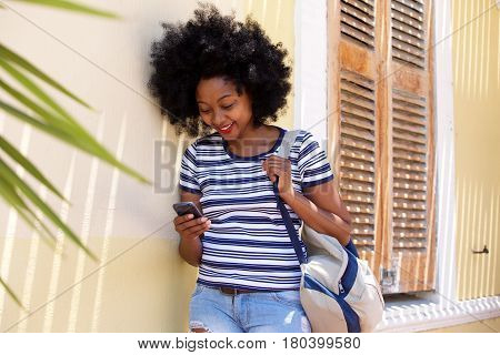 Smiling Woman With Mobile Phone Standing Outside