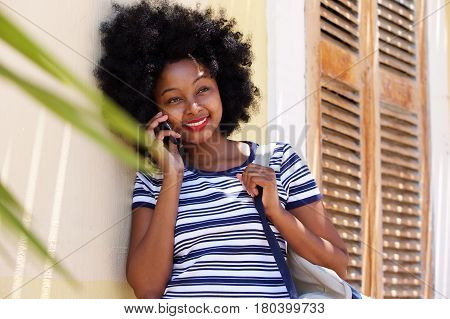 Smiling Woman Standing And Talking On Mobile Phone