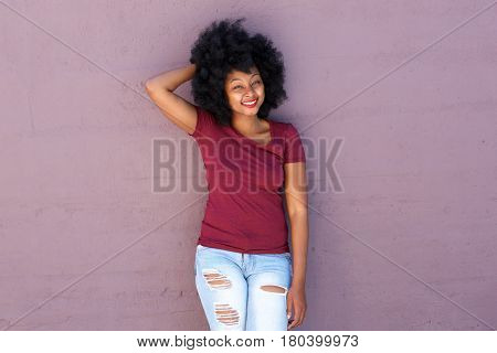 Beautiful Friendly Woman Standing With Hand Behind Head Smiling
