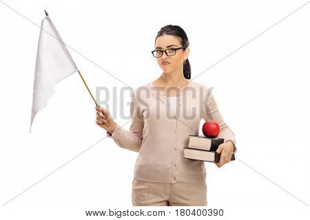 Disappointed female teacher holding a white flag isolated on white background