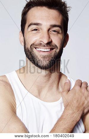 Stubble man smiling at camera close up