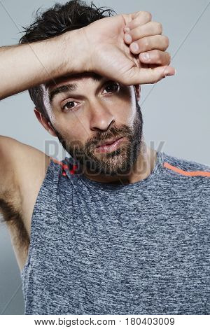 Hot guy wiping sweat from brow portrait