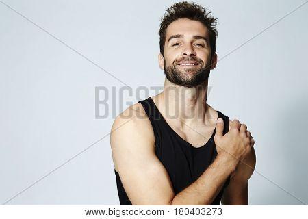 Stubble guy with head back in studio portrait