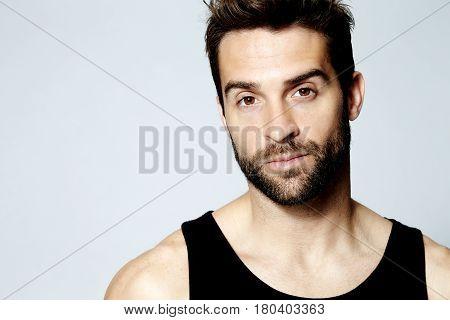 Handsome Stubble guy in vest portrait studio