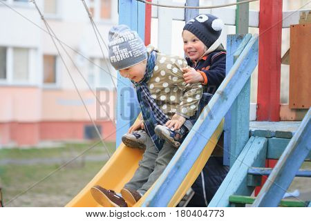 Gomel, Belarus - 6 April 2017: Unfamiliar Children Play On The Playground In Early Spring.