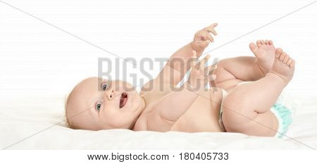 Adorable baby girl  in pampers on blanket
