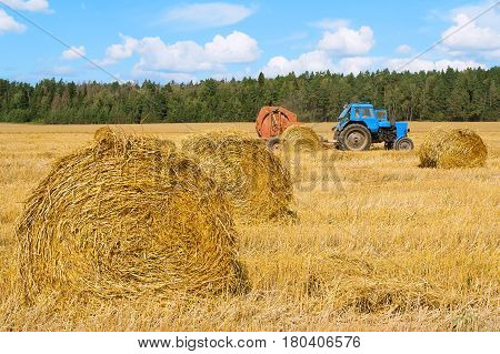 Tractor at work in the field. Agriculture farm