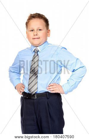 Portrait of a big confident boy wearing classic shirt and tie. School uniform. Education. Isolated over white background.