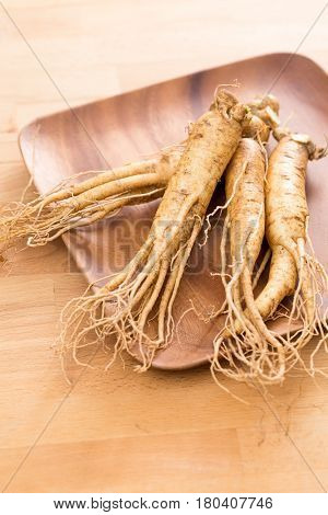 Ginseng over wooden background