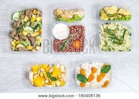 A set of delicious and healthy food for a whole day in a food container for a break between sports
