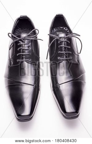 Front view of black leather shoes on a white background