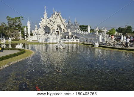 Wat Rong Khun the White Temple art exhibit in the style of a Buddhist temple in Chiang Rai Province north Thailand.