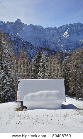 A small wooden hut in the snow on the slopes of Monte Lussari Friuli Venezia Giulia north east Italy