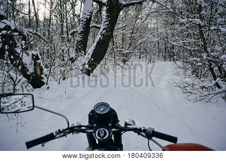 Motorcycles with sidecars in winter wood in Ukraine
