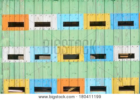 Abstract coloured beehives in spring time, close up