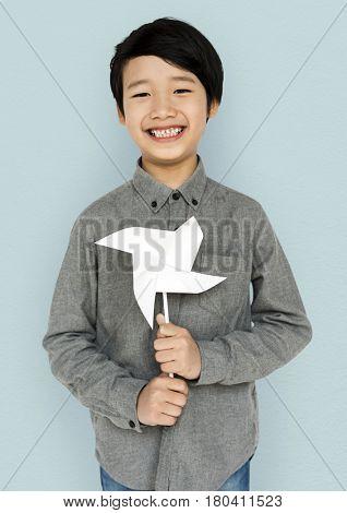 Little Boy Hands Holding Paper Wind Mill Studio Portrait