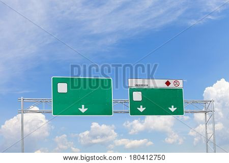blank green highway road sign on sky background.