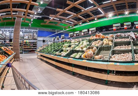 Samara Russia - February 24 2017: Interior of the supermarket Lenta. One of largest retailer in Russia. Fresh vegetables and fruits ready for sale