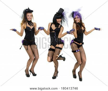 Three sexy girls wearing a bunny costumes posing against isolated white background