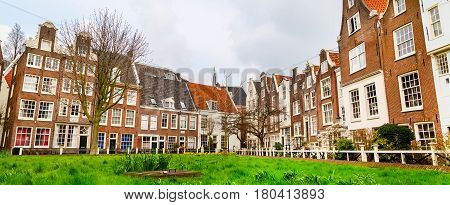 Dutch traditional Holland houses in Amsterdam, Netherlands panoramic banner