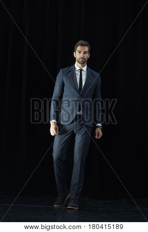 Smart dude in full suit black background