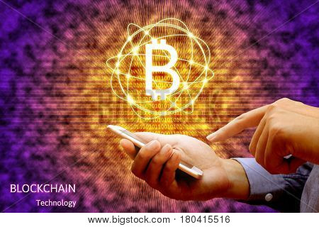 Blockchain Technology Concept, Businessman Holding Smartphone And Virtual System Diagram Bitcoin.