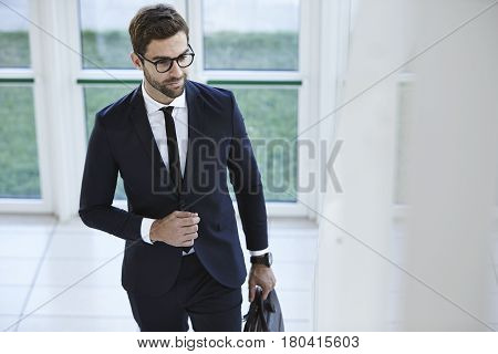 Man in suit and spectacles with briefcase