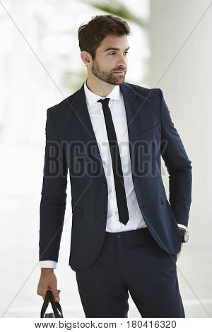Sharply dressed suit and tie businessman looking away