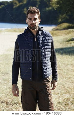Handsome Hiking guy in body warmer portrait