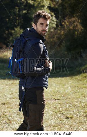 Dude with a backpack on a hike portrait