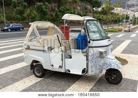 FUNCHAL PORTUGAL - SEPTEMBER 2 2016: Tuk tuk classic retro excursion car for tourists. Madeira island Portugal.
