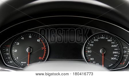 Modern black car instrument panel with different displays