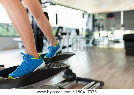 Woman practice on Elliptical machine