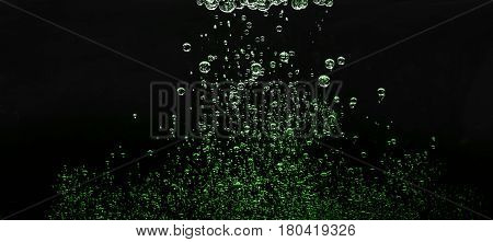 bubbles in water on a dark background. waterdrops