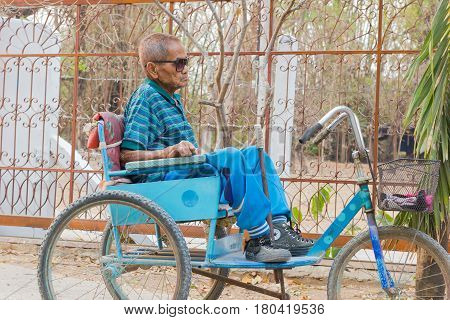CHIANG RAI THAILAND - FEBRUARY 19 : Unidentified asian man suffering from leprosy on tricycle on February 19 2016 in Chiang rai Thailand.