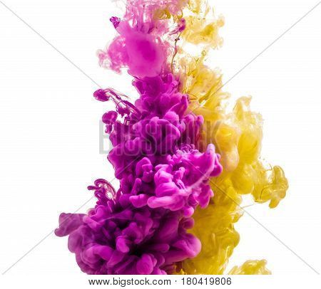 colorful ink isolated on a white background. a pink yellow drop swirling under water. Cloud of ink in water.