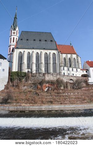 Church In Cesky Krumlov With Vltava River And Weir