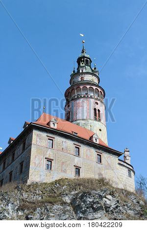Castle in Cesky Krumlov on rock with blue sky