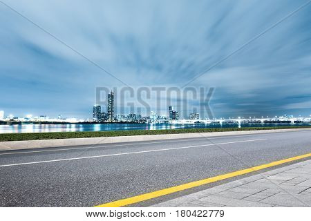 cityscape and skyline of modern city from empty road