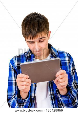 Troubled Young Man with Tablet Computer Isolated on the White Background