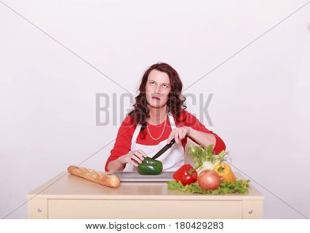 a dark Cut annoyed woman in vegetables