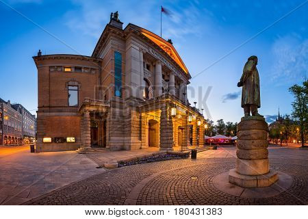 Panorama of National Theater and Henrik Ibsen Statue in the Evening Oslo Norway