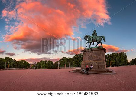 OSLO NORWAY - June 11 2014: The Royal Palace Square in Oslo. The palace is the official residence of the present Norwegian monarch and it has 173 rooms.