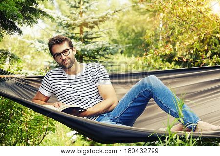 Portrait of guy on garden hammock relaxing