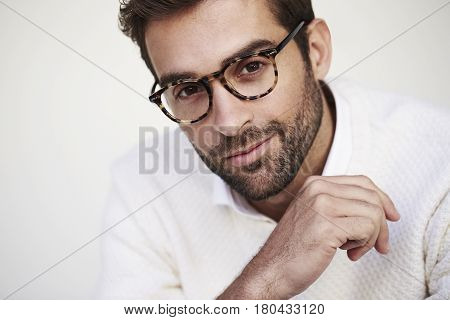 Stubble man in spectacles portrait studio shot