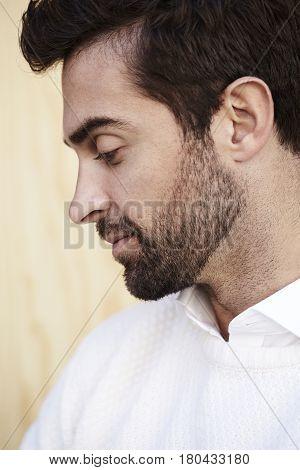 Stubble guy in profile close up studio shot