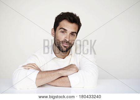 Stubble dude in white sweater portrait studio shot