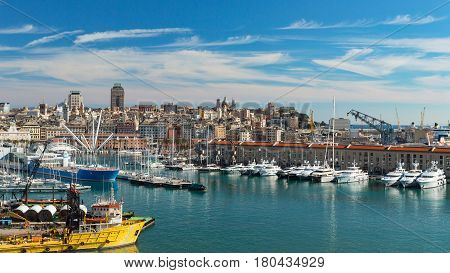 Genoa Liguria Italy - February 26 2017: Serene panoramic view of old port in Genoa the major Italian seaport on the Mediterranean Sea with cityscape of Genoa town.